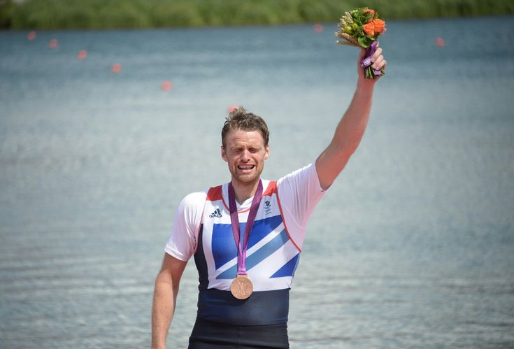 Great Britain's Alan Campbell cries as he poses on the podium with his bronze medal won for the men's single sculls final A of the rowing event, at Eton Dorney Rowing Centre in Eton, west of London, Aug. 3, 2012