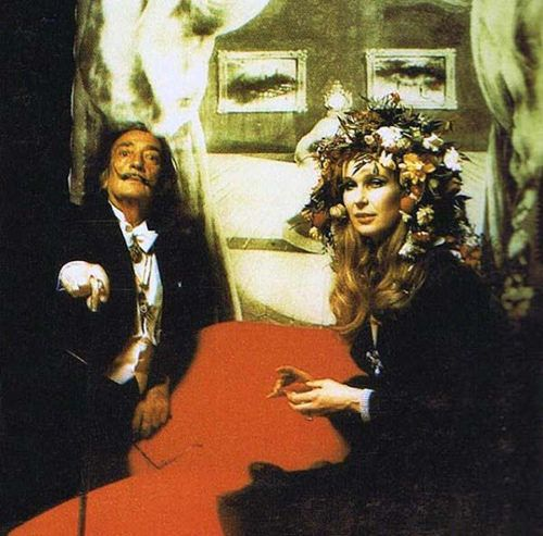 "Marie-Hélène De Rothschild and Baron Guy De Rothschild, members of one of the most wealthy and powerful bloodlines on Earth, threw their now infamous ""Illuminati Ball"" at the Rothschild estate Château De Ferrières in 1972. This phantasmagorical soirée included a guest list that included world leaders, industrial moguls and bonafide celebrities such as Aubrey Hepburn and Salvador Dalí. This rare photo taken from the event shows Dalí posing in front of his famous depiction of Mae West."