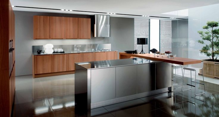 Modular kitchen in walnut | Filanta is a modular kitchen in walnut with a strong personality and innovation thanks to the rational design of his door. In fact, the beauty of the project is expressed in clean lines that provide a picture but very minimal function. The originality of Filanta is also expressed in his compositional possibilities that integrates the functions of the kitchen with the living spaces.