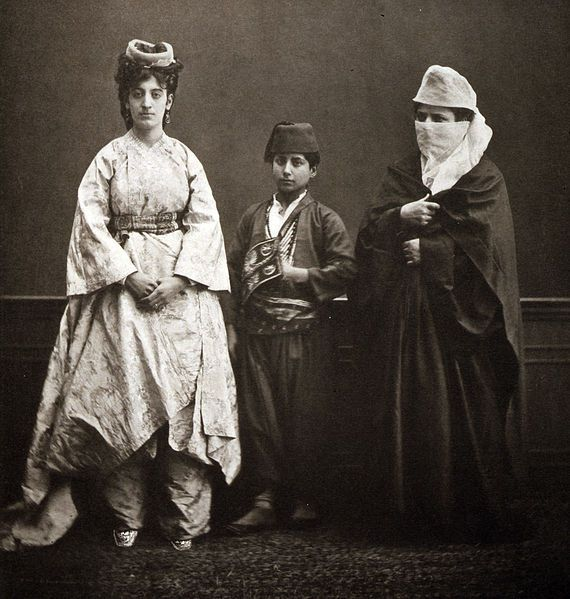 Turkish women and a school boy from Istanbul, 1873.