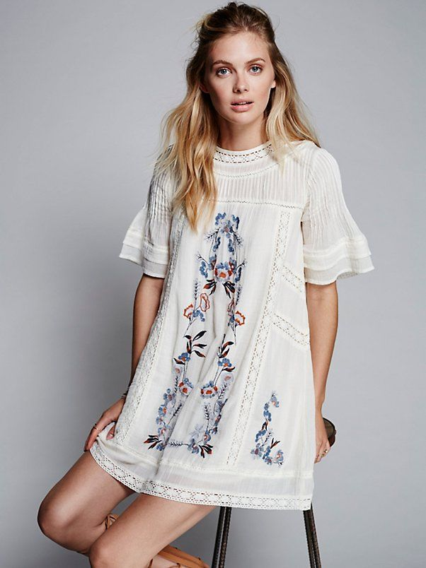 Perfectly Victorian Mini | Effortless and shapeless Victorian-inspired mini dress featuring a beautiful floral embroidery and crochet trim. Pleat detailing along the high neck and wide sleeves. Button closure in back with a keyhole opening. Lined.