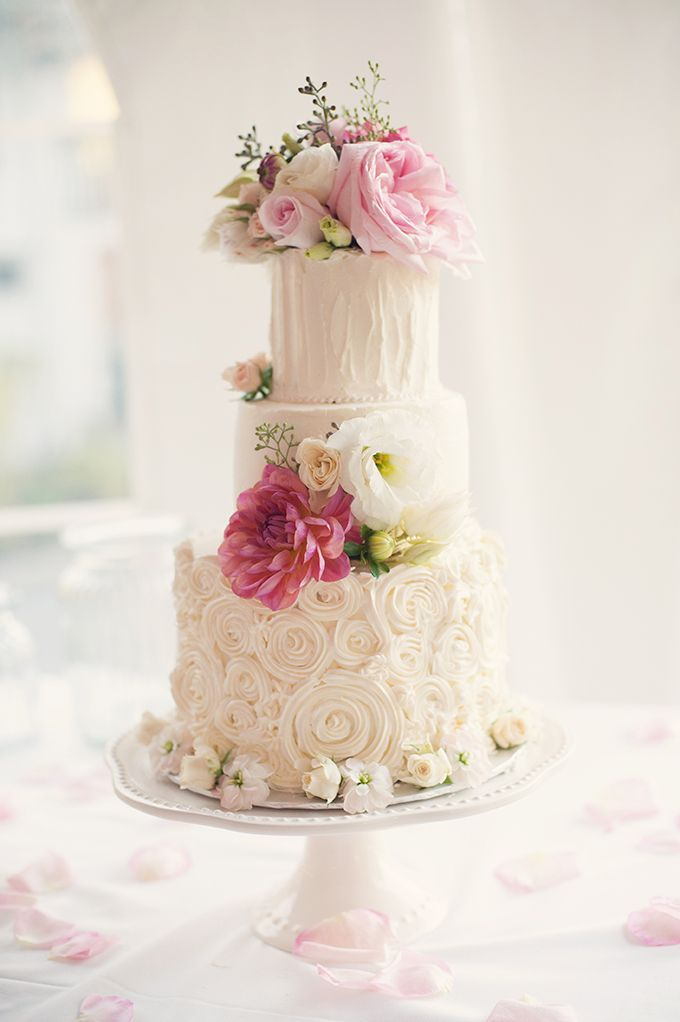 White textured cake with pretty pink flowers