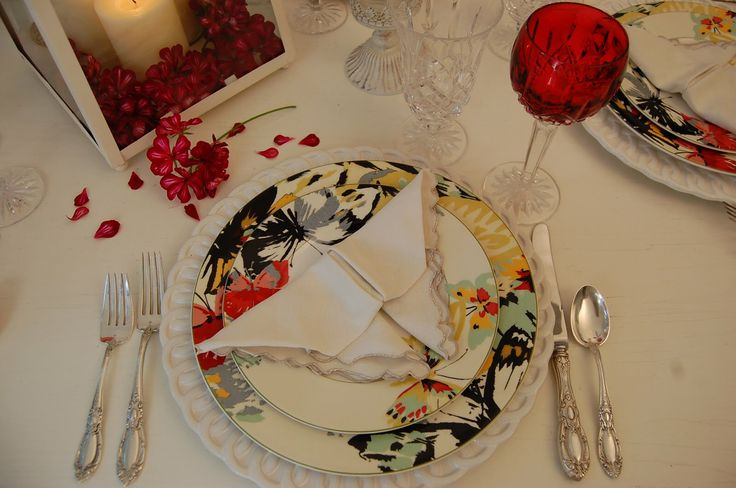 Image from http://legcloud.com/wp-content/uploads/2014/11/romantic-tablescaping-candle-light-dinner-decoration-butterfly-napkin-fold-lilies-flower-table-decoration-vintage-white-table-lantern-as-centerpiece-thanksgiving-table-napkin-folding-decorations-crea.JPG.