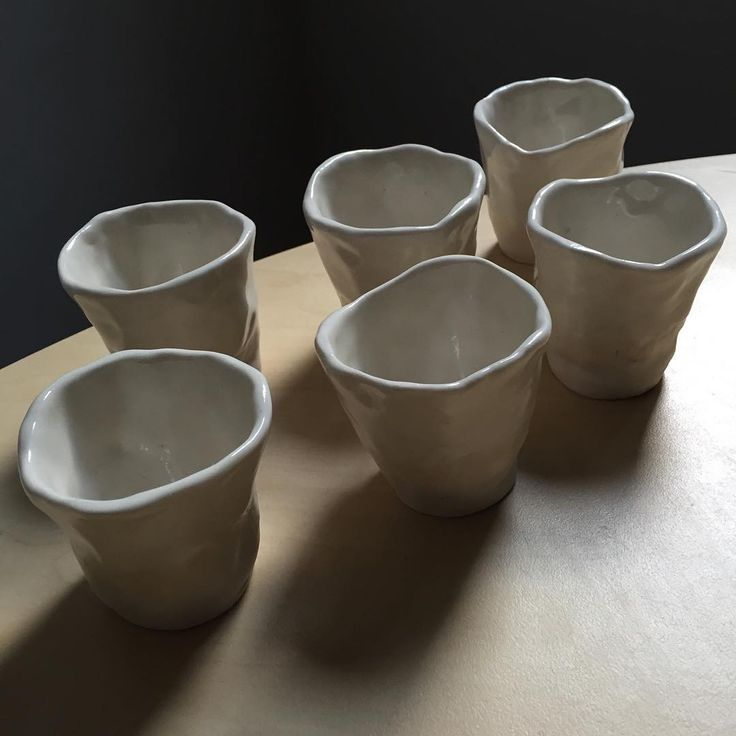 Set of 6 wonky piccolo cups. I love the irregularity of these cups. As you hold them you move them around in your hand to find the best way to drink from them and each turn is like holding a different cup. Drinking from them is also an unusual experience as your lips are taken by surprise by the change to the run of the mill smooth round straight rim they are used to. Who wants a boring cup?