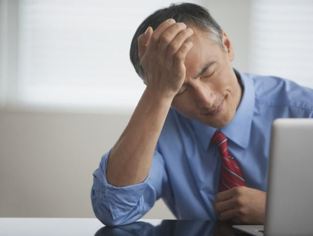 Do You Have Early Onset Alzheimer's? Signs of Early Dementia at Work: Stressed Man/ SelectStock Collection: Vetta /Getty Images