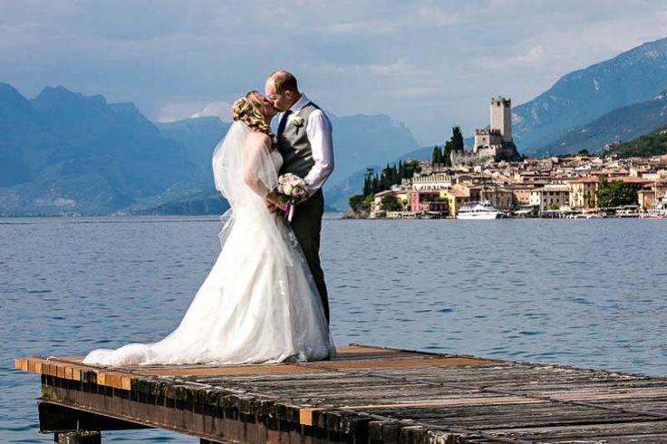 Romantic Weddings on Lake Garda | Wedding planners for the most romantic Lake Garda weddings in Italy•Malcesine Castle in the background.