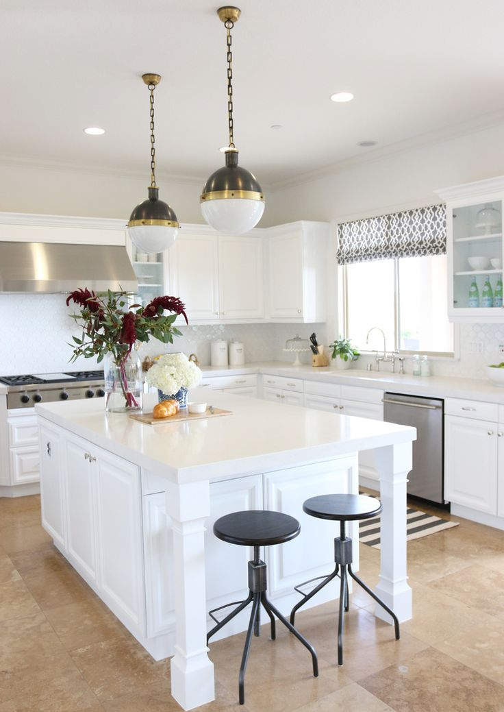 "Caesarstone ""Frosty Carrina"" countertops, Valspar white lacquer cabinets, BM-White Heron walls and ceiling"