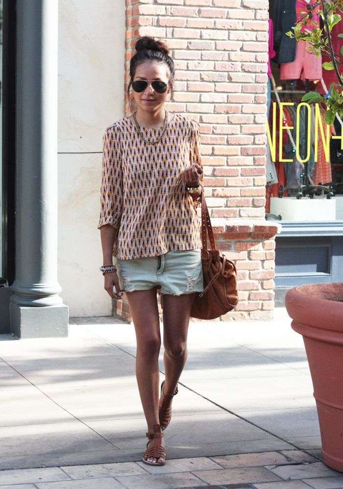 cut off shorts, patterned top, sandals and high bun. @Sincerely Jules