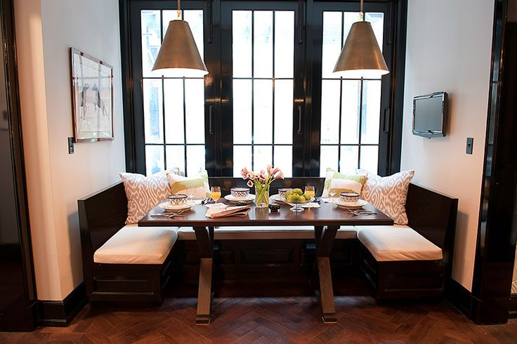 Herringbone floors, stunning original windows, ikat textiles, a built-in banquette and some fabulous hanging pendants from Circa Lighting
