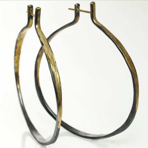 Ayesha Mayadas' Splash Hoop Earringsare made from 14K Yellow Gold and Sterling Silver. These intentionally off round earrings are individually forged.