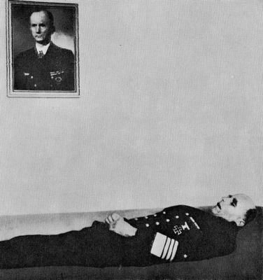 Admiral Hans-Georg von Friedeburg  ( (July 15, 1895 – May 23, 1945) after his suicide. Note portrait of Großadmiral Karl Dönitz on the wall above the body.