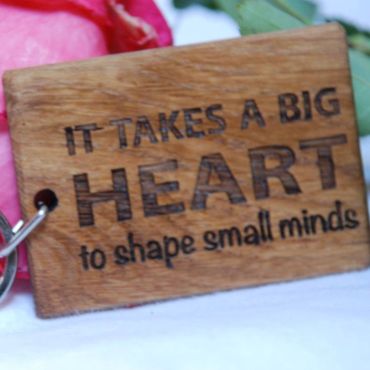 A lovely quote to make your child's teacher smile everyday.Made from oak, and laser engraved with the message 'It takes a big heart to shape small minds' makes this a perfect gift for your child's teacher. All too often you struggle buying token gifts but this can be hung with pride from a set of keys for the recipient to realise everyday how much they have been appreciated. Solid oak, with a Danish oil finish.Height - 5cm Width - 7cm Depth - 0.6cm