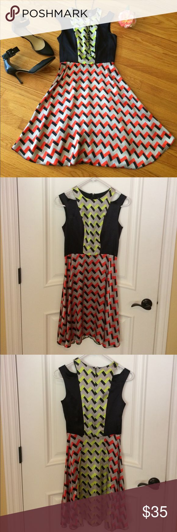 """💃 River Island (UK) Designer Neon Dress Misses 6! Beautiful Black, Gray, Neon Orange & Neon Green Dress by River Island Design Forum! UK Size 8 Converts to US Size 6 Also - See Photo showing Tape Measurements. This eye-catching piece has beautiful Shoulder Cut-Outs, & a Pretty Flare at the Bottom of the Dress. Very figure-flattering Zig-Zag Design. Zipper down back. 100% Viscose (no lining). Above knee on me (5'7""""). This Dress can easily go from Work to Happy Hour! Thank you for 🛒 here…"""