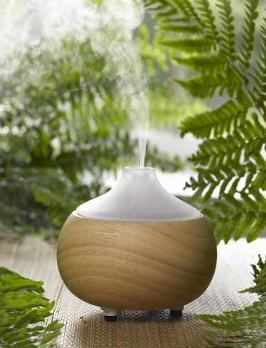 Ultrasonic essential oil diffuser in oak and glass with LED light, as well.