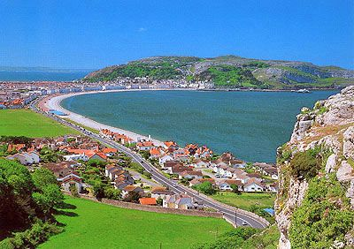 Llandudno, Wales. In the distance is Great Orme head, with the town of Llandudno at its base. This picture is taken looking west from the Little Orme head with Bodafon Fields in the foreground and the little community of Craig Side. (Craig is Welsh for Rocky Cliff). Ysgol (School) Gogarth is just off the picture on the left. rjp.