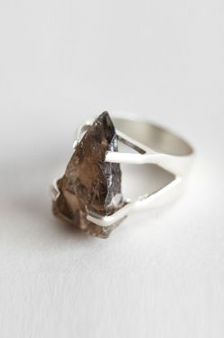Handmade ring of rough cut smoky quartz held with sterling claws claw setting