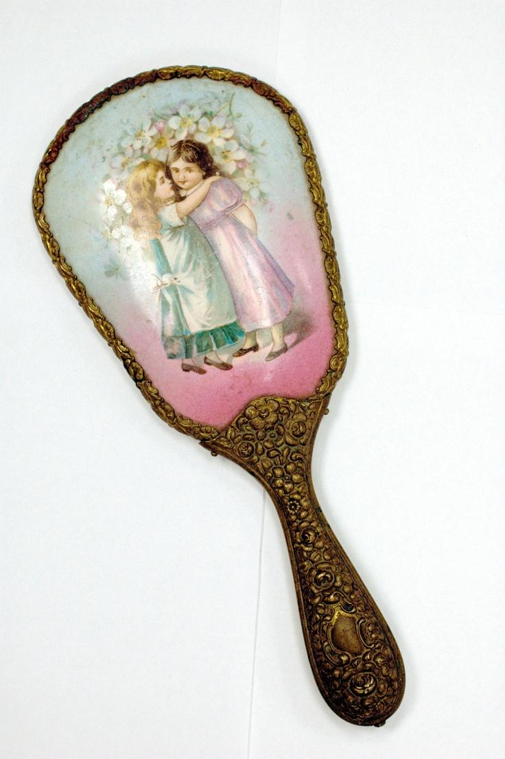 Antique Art Nouveau ornate hand held vanity mirror