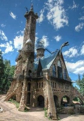 """Bishop Castle in Wetmore, Colorado   ..... For 40 years, Jim Bishop has been building a castle on a mountainside in central Colorado. """"Did it all myself, don't want any help,"""" he says mechanically as he unloads a pile of rocks that he's hoisted to the 70-foot level on one of the castle towers.   Every year since 1969, Bishop has single-handedly gathered and set over 1000 tons of rock to create this stone and iron fortress in the middle of nowhere."""