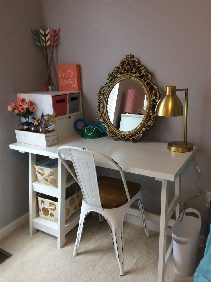 DYI desk/vanity for my 9-year-old's new bedroom.  Trundle desk from Amazon $99 (free shipping with Prime), chair $50 from Hobby Lobby, and mirror $25 from Walmart!  Other items from Hobby Lobby, Target & Michael's.  Most items were 40-50% off!  Love it in her coral/gray/teal/gold room!