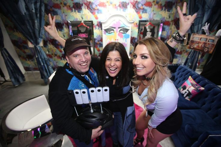 Naomi Shapiro, middle owner of Rock N' Karma poses with Richard Trus, left, and Sydney Eatz from Google Local Guides Toronto in her Queen St. West store.