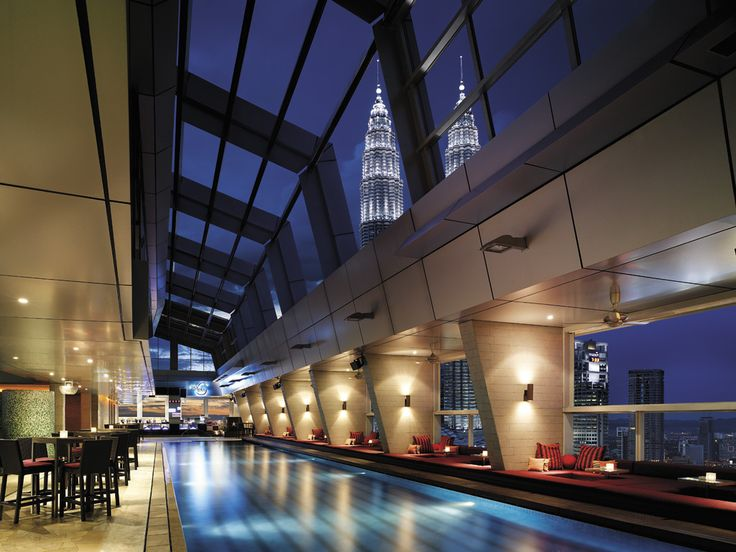 At Traders Hotelin Kuala Lumpur, Malaysia, snuggle up in a private booth or dance poolside at SkyBar, a rooftop pool with views of the Petronas Towers and the Kuala Lumpur skyline. Just a word to the wise: Don't jump in — this pool is not for swimming.