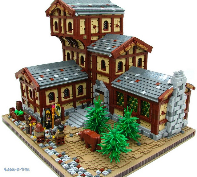The Drake's Head Inn by Sirens-Of-Titan.  This MOC is gorgeous.  I love the cobblestones, the bushes/trees are genius!  The way the Inn keeps growing with all the different levels jutting out.  Also the use of color continuity by having the brown, red and white appearing randomly in the roofs.  Well done.  Very well done.