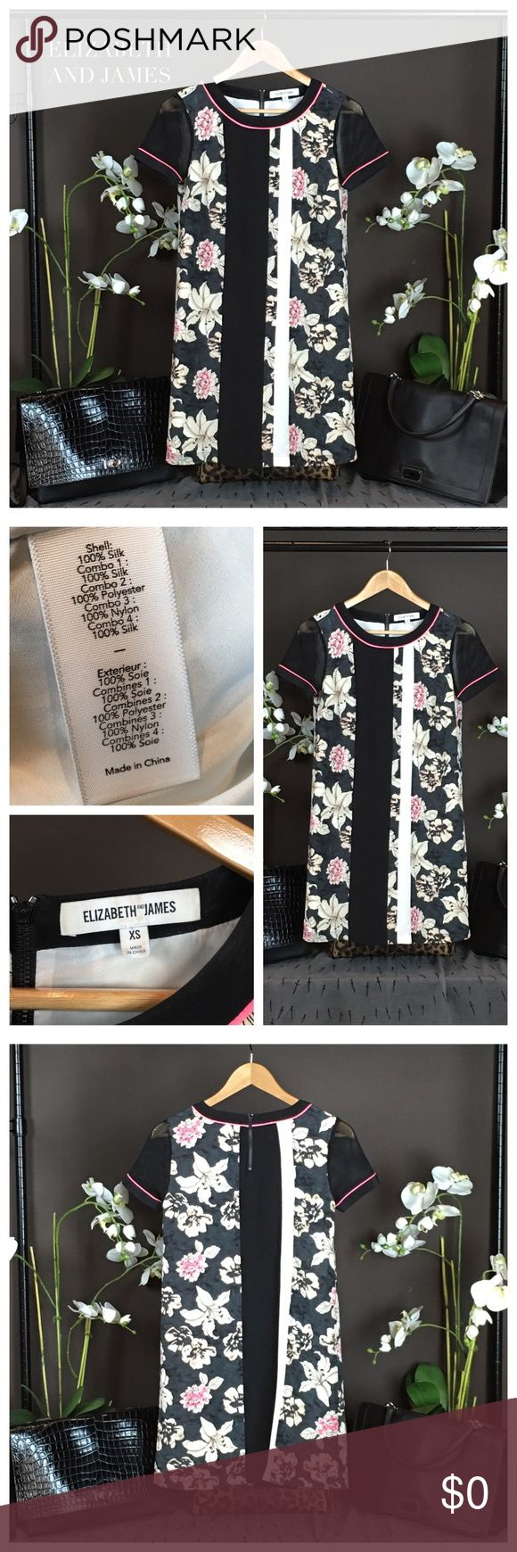 """Elizabeth and James Dress Creating a strong contrast with striking visuals, this dress from Elizabeth and James features a multi-colored floral centre with black mesh sleeves and pink trims. Material 1: 100% Silk; Mat 2: 100% Polyester; Mat 3: 100% Nylon; Mat 4: 100% Silk. Size XS Approx. Measurements: 32-33"""", Length; 35.5"""" Bust: 34"""", Waist 32"""" Hip: 38"""", Length: 34"""". SOLD OUT! Condition: Excellent. Pair w skinny jeans & boots Elizabeth and James Dresses"""