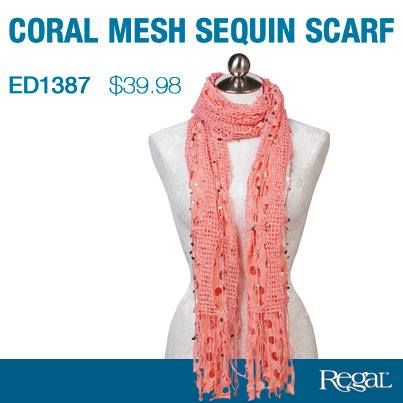 """MESH SEQUIN SCARF - CORAL  Wrap yourself in fabulous style! Long, soft scarf is adorned with glittering sequins and finished with a delicate fringe. Polyester. 72""""L x 14""""W."""