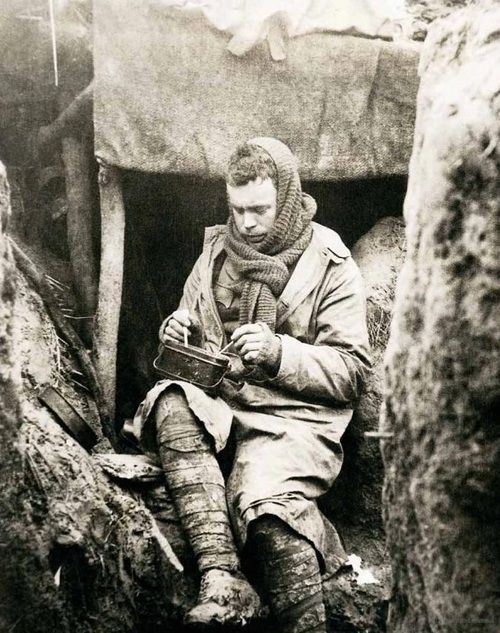 A British soldier eats his dinner in the trenches, 1917.