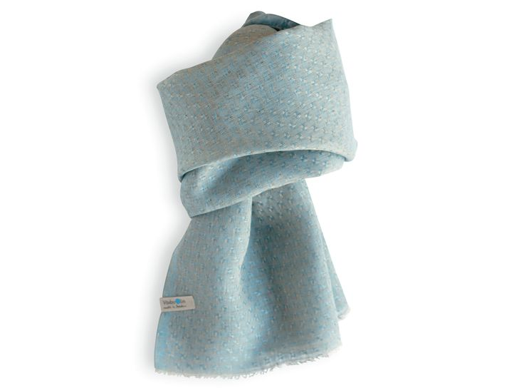 Shawl made of 100% linen in a soft light blue colour. Made in Sweden. Unisex. Good enviromental choice.