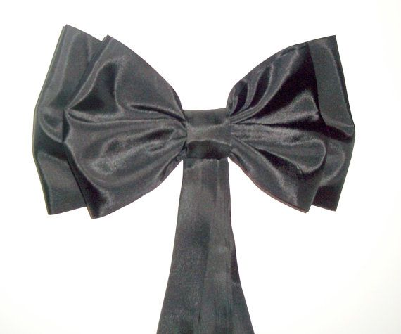 Maybe for pews because they look like bow ties, if we go a more upscale route, however church is very rustic......Black Taffeta Pew Bows White Taffeta Pew Bows by shannonkristina, $75.00