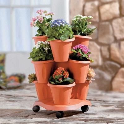 Mobile Garden Planter – Plant 9 herbs or flowers in this small apartment garden planter. Caster wheels allow you to roll it around when you need to.Small Apartments, Garden Planters, Mobiles Gardens, Gardens Tools, Minis Gardens, Landscapes Rocks, Apartments Gardens, Gardens Planters,  Flowerpot