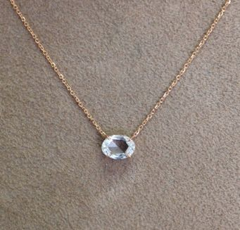 "18k rose cut oval-shaped diamond pendant.  20"" rose gold chain. .82cts diamond"