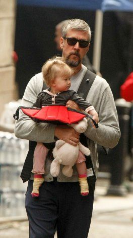 10 celeb baby wearing dads | BabyCenter Blog. Spin City's Alan Ruck with his daughter Vesper