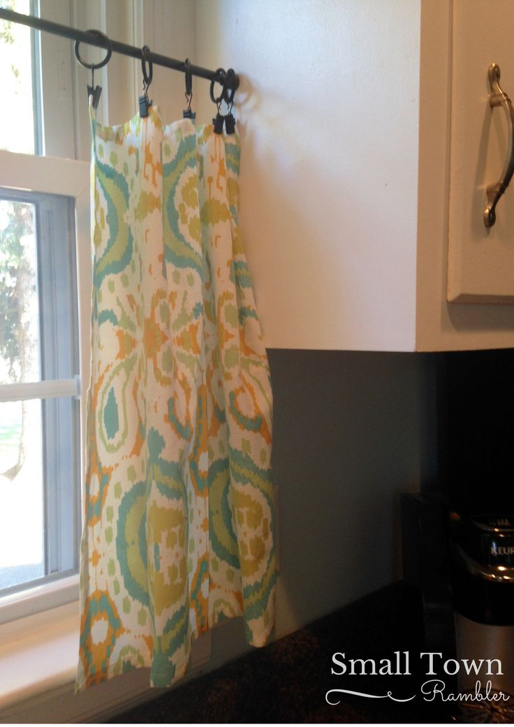 Napkins from World Market added to curtain clips and tension rod for cafe curtains in kitchen window.