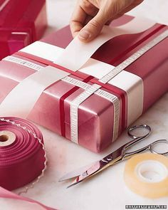 Woven Ribbon Wrap | Martha Stewart Living - Here's our idea of thinking outside the box: interweaving ribbons to dress up a gift. The weaving begins with a single ribbon stretched across the top of the package, its loose ends fixed to the bottom with double-sided tape.