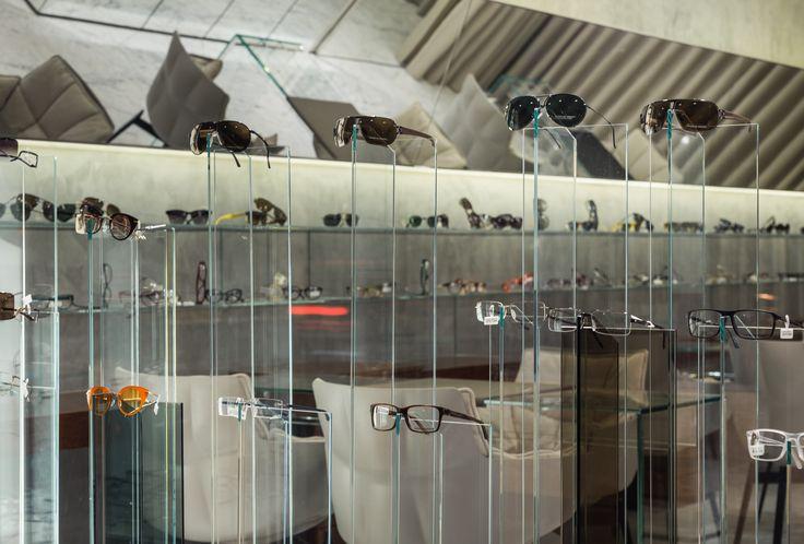 XYZ Arquitectos Associados - Óptica Moutinho - Porto - Portugal - interior design - optical store - Husk chair B&B Italia