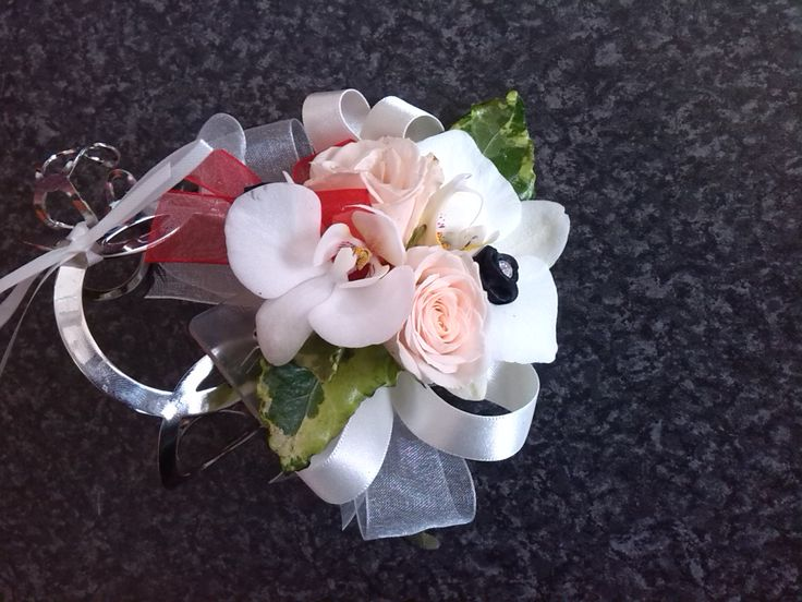 Our lovely silver bracelet, white Orchid debs corsage with a hint of pink and black