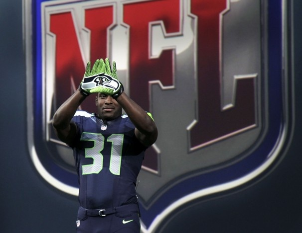 Not really digging the new Seahawks uniforms but those gloves are freaking awesome, I want them!