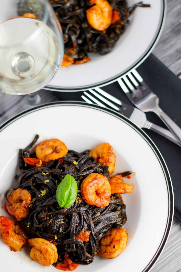 This recipe for Squid Ink Linguini pasta with Shrimp + Cherry Tomatoes only looks fancy. Easy to make in under 30 minutes + the flavor is simply delicious!