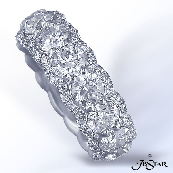 JB Star eternity band with round brilliants diamonds edged in pave. Available at Alson Jewelers.