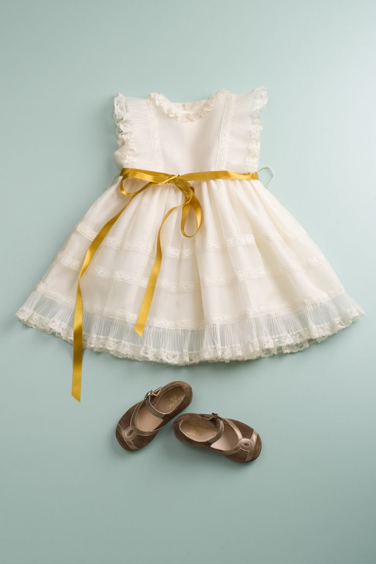 Things little girls should own: a frilly dress and babydoll shoes.