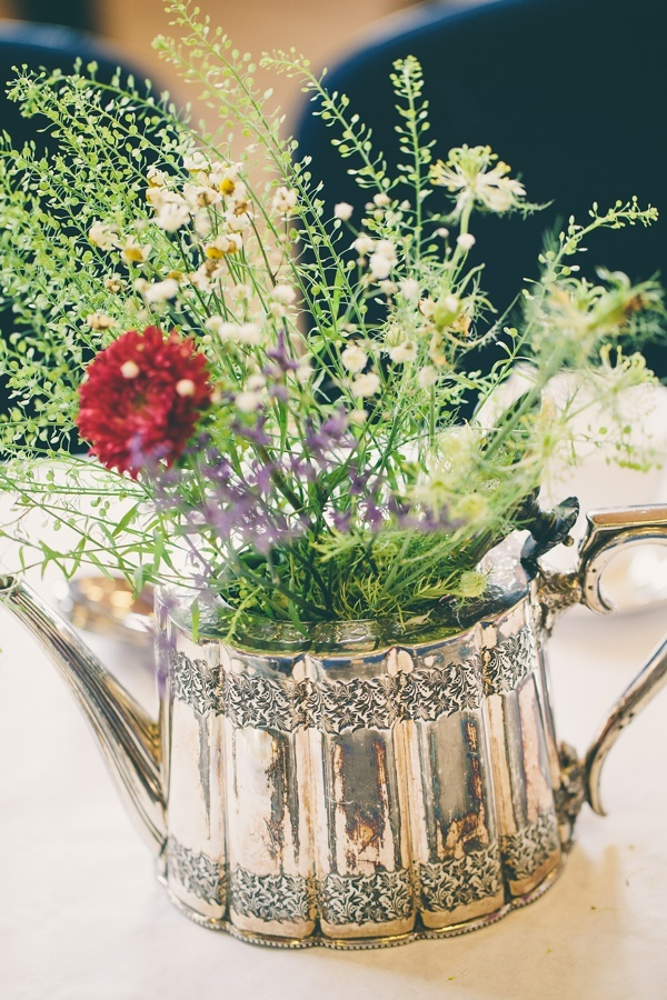 Wildflower table centrepieces in a beautiful vintage teapot