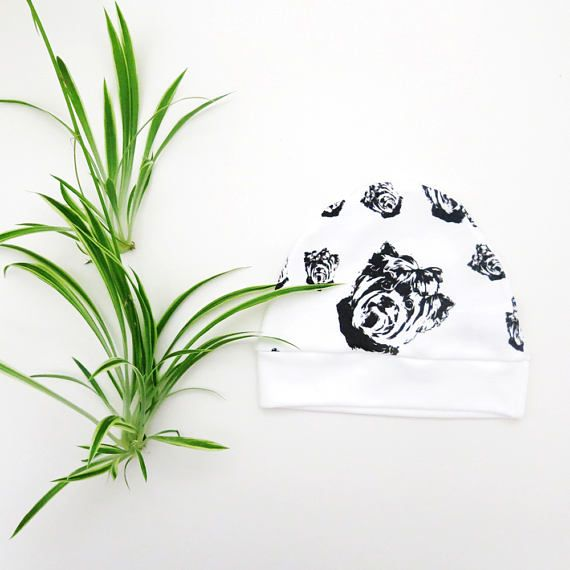 This Organic Cotton newborn hat features unique Yorkshire Terrier Dog print so your baby wears new hat with the image of their favorite dog.   LISTING INCLUDES:  - Organic Cotton newborn hat with Yorkshire Terrier Dog print.  FEATURES:  - High quality Organic Cotton knit baby hat  - Unique image printed using eco and baby friendly ink - This Baby Hat is available for newborn only - Organic Cotton GOTS certified /  Yorkshire Terrier Newborn Hat Yorkie Newborn Baby Beanie /