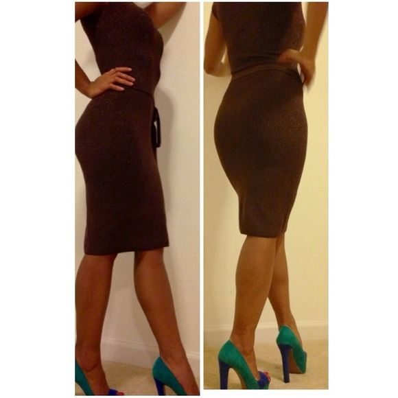 Bebe bodycon dress. Never been worn. Bebe brown bodycon dress bebe Dresses