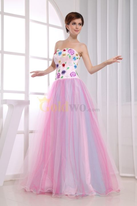Esplendido! will be the reaction you'll get on your Quinceanera with this colorful strapless dress. The bodice has a lace up back for a lovely fit. It has floral appliques all over for a pop of color and youthful spirit. The tulle skirt...