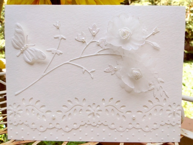 This is for the White on White challenge CAS174  Watercolor card stock ( for a little texture)  Memory Box Honeyblossom Sprig Nellie Snellen butterfly Martha Stewart border punch Swiss Dot EF SU half pearls on flowers and butterfly Stardust Stickles (I put a dot of stickles on all the dots of the EF, around the flowers and on the flowers of the Memory Box die) Unknown flowers from my stash