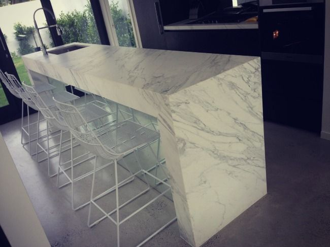 Caesarstone rather than marble for practicality and cost.