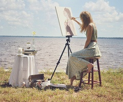 Sitting on a lake or Ocean outside painting like this girl <3