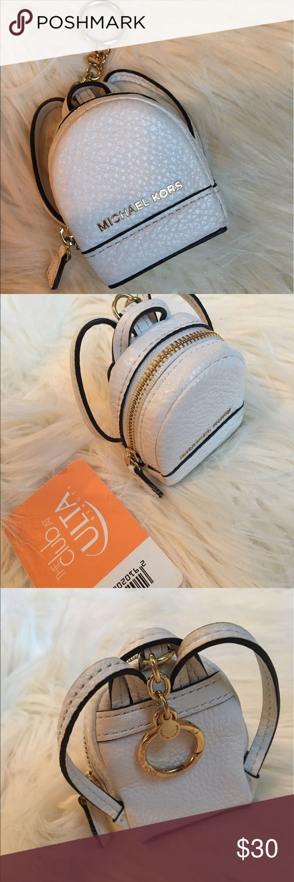 Michael Kors Coin Purse Mini Backpack Keychain Authentic. White leather, super cute, I could resist buying it! Holds a lot of coins and the zipper is easy access. Looks cute on your purse or pack pack or with your keys. Made very well. Put next to my Ulta card for size comparison. Michael Kors Bags Mini Bags